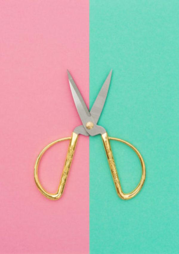 Vintage scissors on color hipster background. Minimal concept