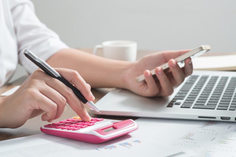 Close up female accountant or banker making calculations. Saving