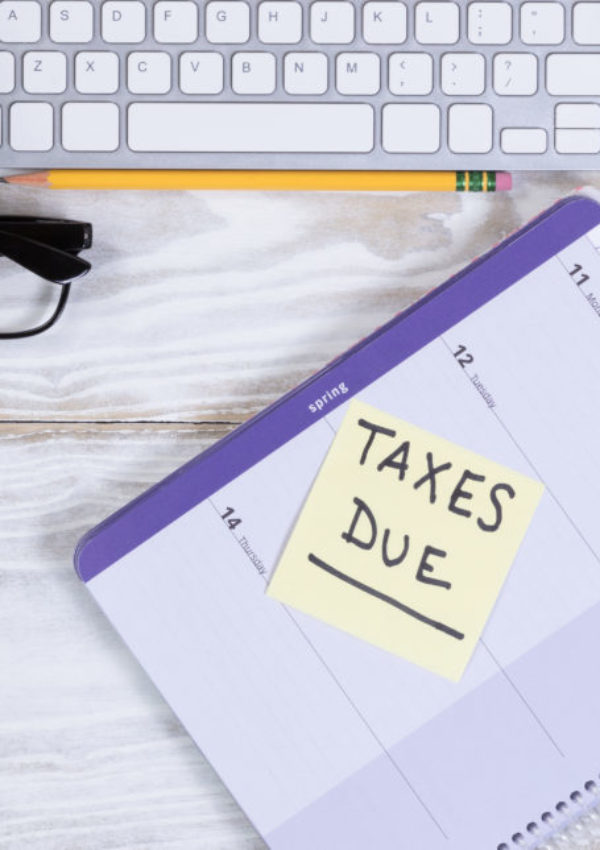 Tax season with supplies on wooden desktop